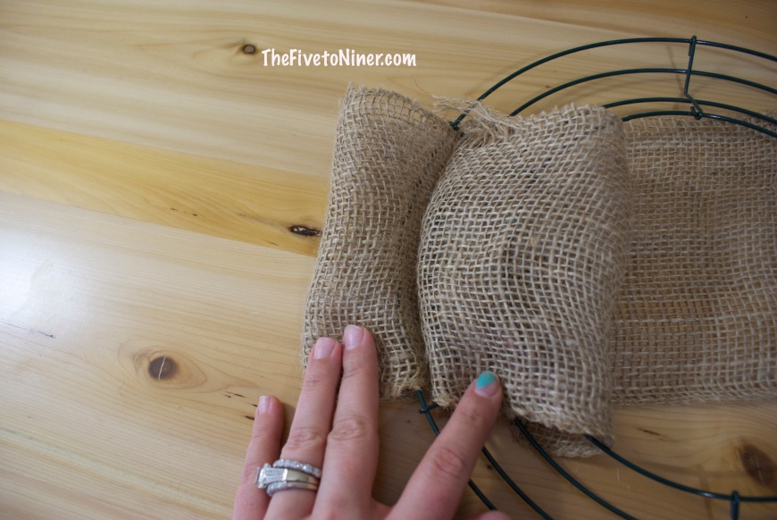 Step 2 - Flip the wire frame over and tuck the short end of the burlap under a wire to secure it.