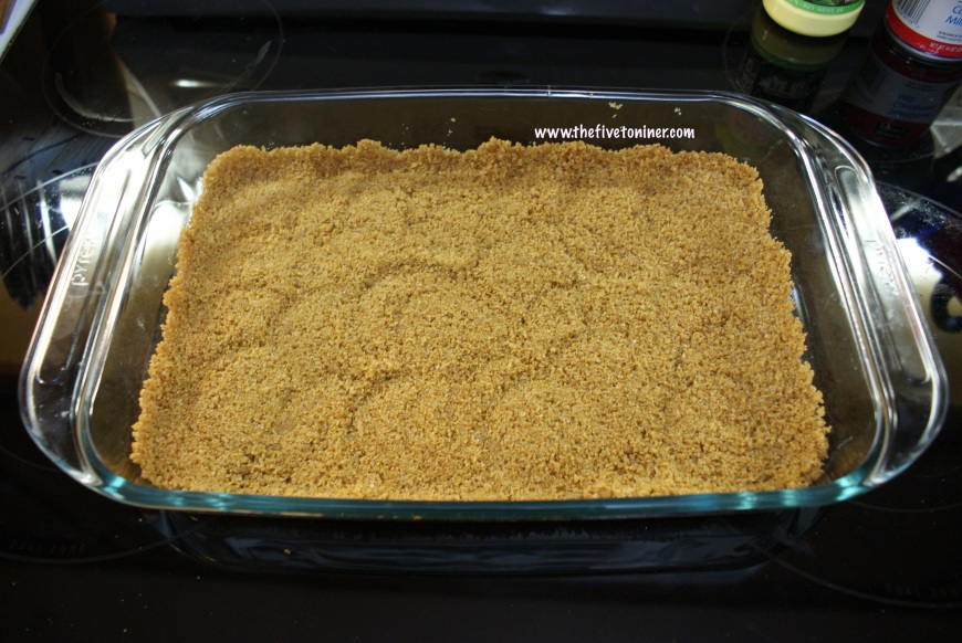 Once the entire crust has been pressed in the dish, put in oven to cook.