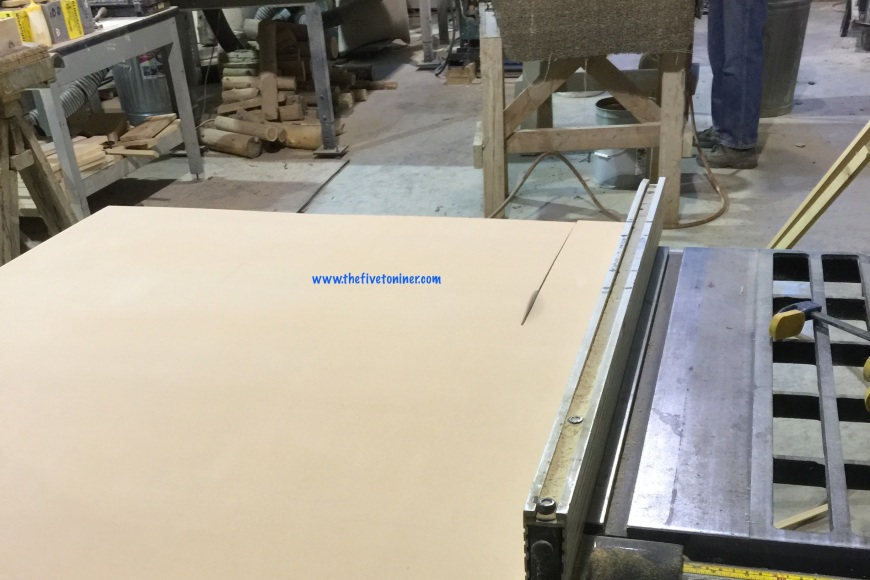 Next up, we cut some finishing plywood on the table saw to use as backing on thread rack.