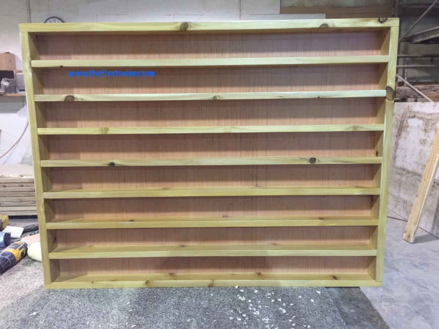 Once your shelves are nailed in place you can remove the spacers and that's it!  You're ready to hang it up!